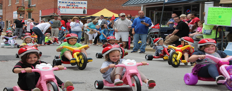 The favorite activity of the younger visitors to Paintsville's Spring Fling 2016.  What these cut kids don't know yet, is that they will be able to KEEP their Big Wheel trikes after the race!
